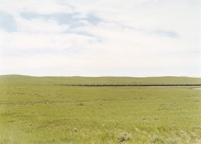 Victoria Sambunaris, Untitled, 2001, (Distant train with plains, Gillete, WY) C-Print, ed. 1/5, Collection Lannan Foundation.