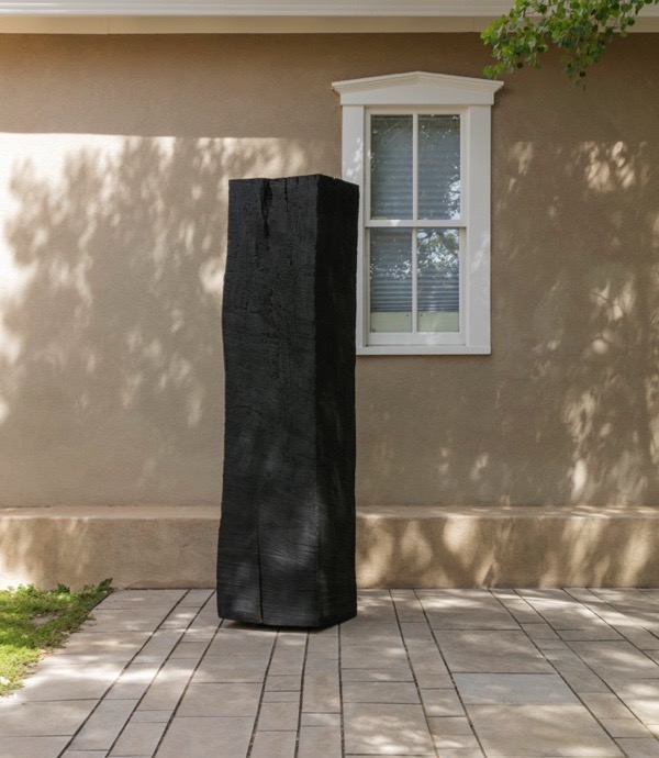 Image: Munson Hunt,Charred Monolith, 2011, (from the Series: Reclamation), burned cottonwood, 87 x 20 x 20 inches, edition: 1/10, Collection of the Artist