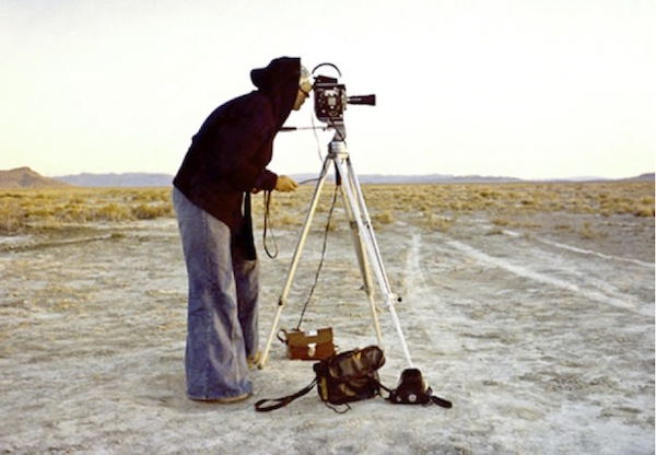 photo of Nancy Holt filming Sun Tunnels