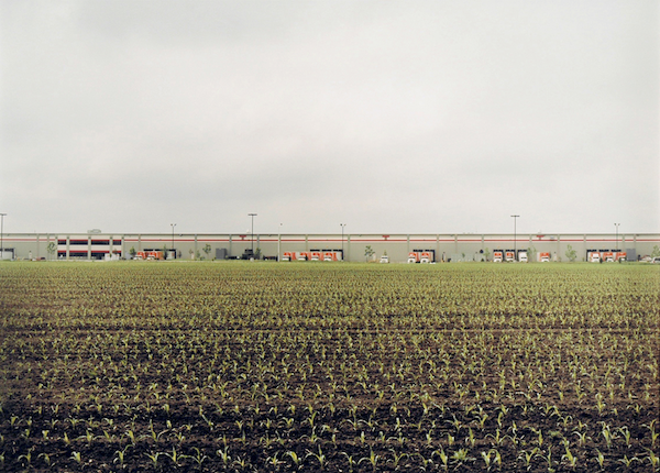 Untitled, 2001 (Distant orange trucks docked with cornfield, Janesville, WI)