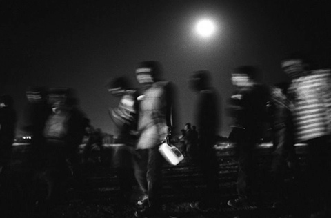 A Group Immigrants Walks Toward The Border Julian Cardona