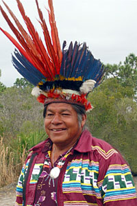 Bobby Billie, Seminole, in traditional Arawak headdress presented by Indian Law Resource Center board member Jean LaRose