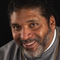photo of Rev. William Barber II with Khury Petersen-Smith